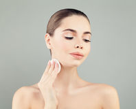 Cute Woman with Healthy Fresh Skin holding White Cotton Pads Royalty Free Stock Image