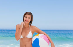 Cute woman with her ball on the beach Stock Photos