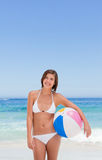Cute woman with her ball on the beach Royalty Free Stock Photography