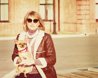 Cute Woman and Her Chihuahua Dog on Nature Background. Royalty Free Stock Photo