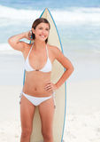 Cute woman with her surfboard Royalty Free Stock Photo