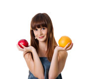 Cute woman hold apple and orange Royalty Free Stock Photos