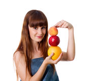 Cute woman hold some fruits. Pretty woman hold some fruits. Studio shot royalty free stock image