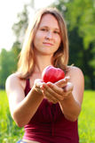 Cute woman holding an apple in her hands Royalty Free Stock Photos