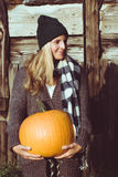 Cute woman holding autumn pumpkin Royalty Free Stock Images