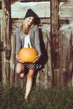 Cute woman holding autumn pumpkin Royalty Free Stock Photos