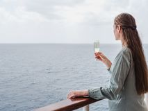 Cute woman holding a beautiful glass of champagne royalty free stock photography