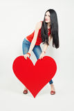 Cute Woman holding Big Heart Royalty Free Stock Images