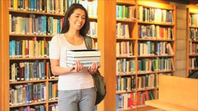 Cute woman holding books stock video footage