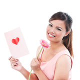 Cute Woman Holding Card And Flower Royalty Free Stock Photography