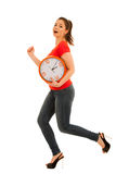 Cute woman holding a clock as a simbol of time management Royalty Free Stock Photos