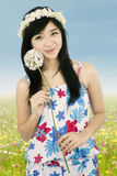 Cute woman holding flower outdoors stock images