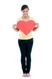 Cute Woman Holding Heart Sign Royalty Free Stock Image