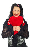 Cute woman holding a heart toy Stock Image