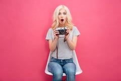 Cute woman holding photo camera Stock Image