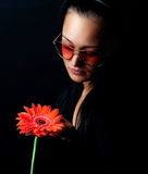 Cute woman holding a red flower Stock Image