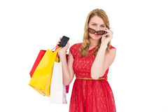 Cute woman holding shopping bags and her smartphone Stock Image
