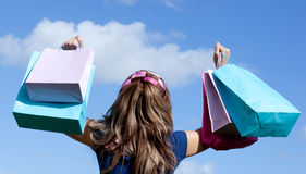 Cute woman holding shopping bags outdoor Royalty Free Stock Photography