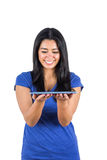 Cute woman holding a tablet pc in her hands Stock Image