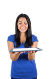 Cute woman holding a tablet pc in her hands Royalty Free Stock Photo