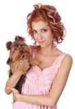 Cute woman holding a tiny dog Royalty Free Stock Photo