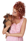 Cute woman holding a tiny dog Royalty Free Stock Image