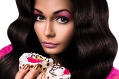 Cute woman holding two cakes Stock Image