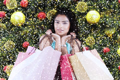 Cute woman holds christmas shopping bags Stock Images