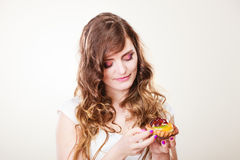 Cute woman holds fruit cake in hand Royalty Free Stock Photos