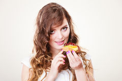 Cute woman holds fruit cake in hand Royalty Free Stock Photography