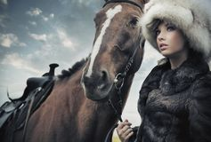 Cute woman with horse Stock Image