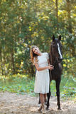 Cute woman with horse Stock Photo