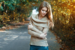 Cute woman in a jersey standing in autumn park. Europe Royalty Free Stock Images