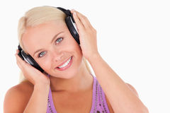 Cute woman listening to music Royalty Free Stock Photography