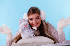 Cute woman with little snowman. Winter fashion. Stock Photo
