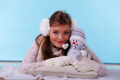 Cute woman with little snowman. Winter fashion. Royalty Free Stock Image