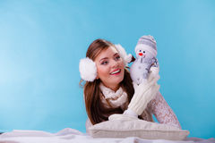 Cute woman with little snowman. Winter. Stock Images