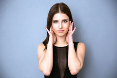 Cute woman looking at camera Royalty Free Stock Photos