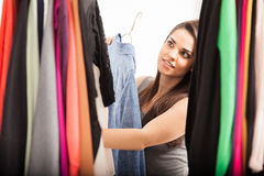 Cute woman looking at her closet Royalty Free Stock Image