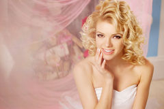 Cute woman looks like a doll in a sweet interior. Young pretty s Stock Image