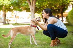 Cute woman in love of her dog royalty free stock photos
