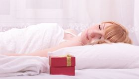 Cute woman lying on bed Stock Photos
