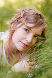 Cute woman lying on grass outdoors Royalty Free Stock Image