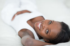 Cute woman lying on her back Royalty Free Stock Images