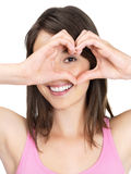 Cute woman making a heart shape with hands Stock Images