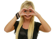 Cute woman making a heart shape with hands Royalty Free Stock Photography