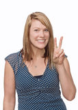 Peace sign. Cute woman making peace sign with fingers royalty free stock photo