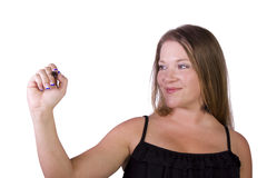 Cute Woman with a Marker Writing. On an Isolated White Backgrond royalty free stock images