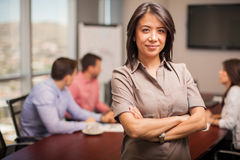 Cute woman in a meeting room Stock Photography