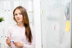 Cute woman near office whiteboard Stock Photos